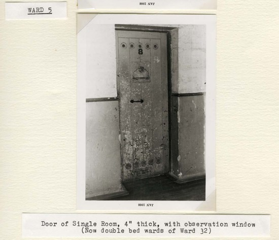 """Gladesville Hospital before renovation, 1966. From NRS 5050, Book of photographs of Gladesville Hospital taken before and after renovation, 1966. Door of Single Room, 4"""" thick with observation window"""