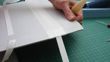 Fig. 13 - The finished tie with the gummed linen tape wrapped over the edge of the flange and stuck down
