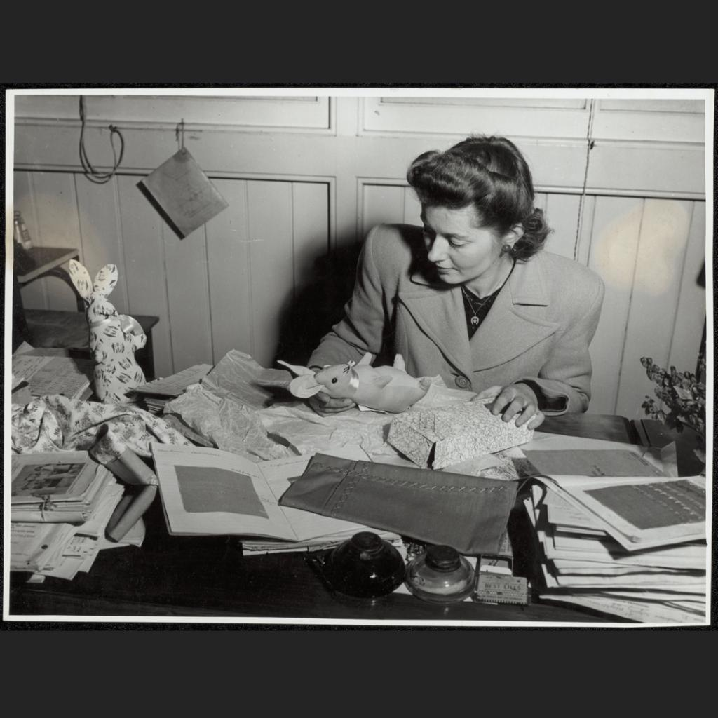 A teacher at the Blackfriars State Correspondence school Sydney, checks the needlework sent in by children in her class who live far away in the country NRS-15051-1-9-501-6